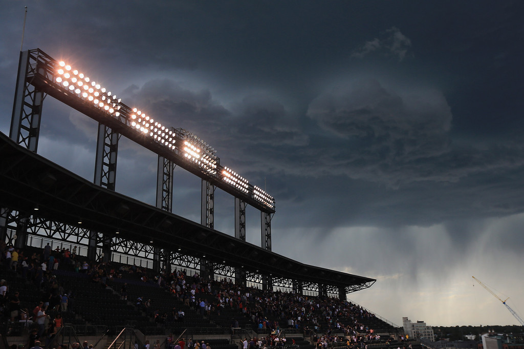 . DENVER, CO - AUGUST 10:  A looming storm with the threat of lightning forces the evacutation of fans from the upper deck and delays the start of the game between the Pittsburgh Pirates and the Colorado Rockies at Coors Field on August 10, 2013 in Denver, Colorado.  (Photo by Doug Pensinger/Getty Images)