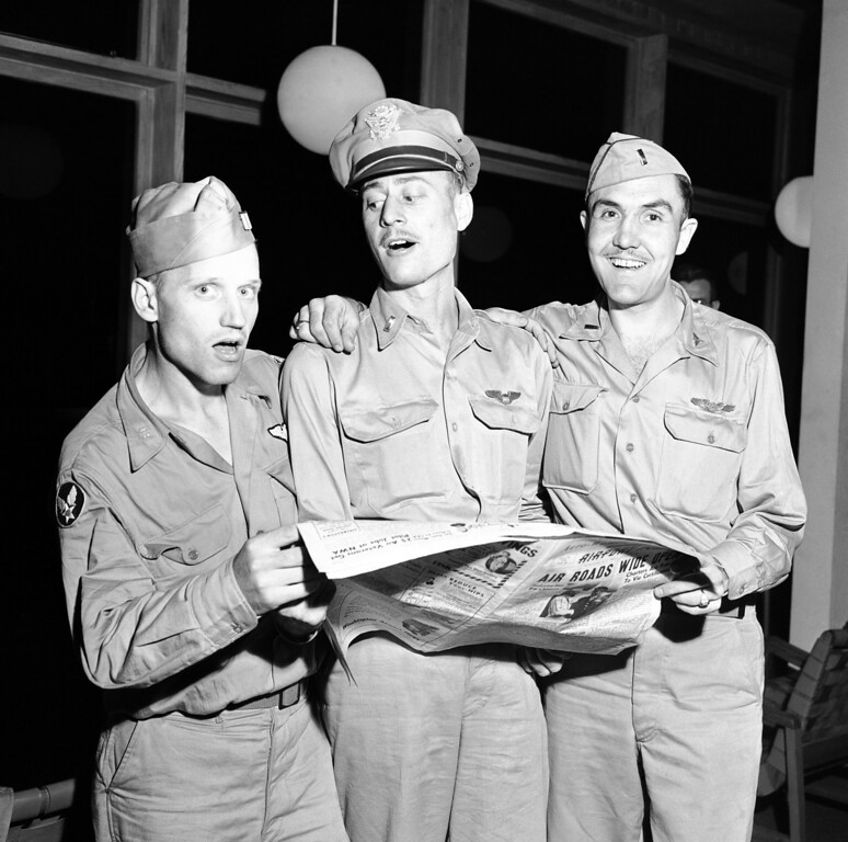 . FILE - In this Sept. 4, 1945 file photo, three of the fliers who raided Tokyo with Gen. James Doolittle in April,1942, are photographed in Washington, D.C.  From left, Sgt. J.D. De Shazer, Salem, Ore, 1st Lt. Robert Hite, Earth, Tex., and 1st LT. C.J. Hielson, Hyrum, Utah. The three fliers left Karachi Sept.1 after being rescued from a Japanese prison.  Thousands of visitors streamed to the national Air Force museum on Saturday, Nov. 9, 2013 to pay a Veterans Day weekend tribute to the few surviving members of the Doolittle Raiders, airmen whose daring raid on Japan helped boost American morale during World War II, as they planned to make their ceremonial final toast together.  Only four of the 80 Raiders are still living, and one was unable to attend because of health issues. (AP Photo)
