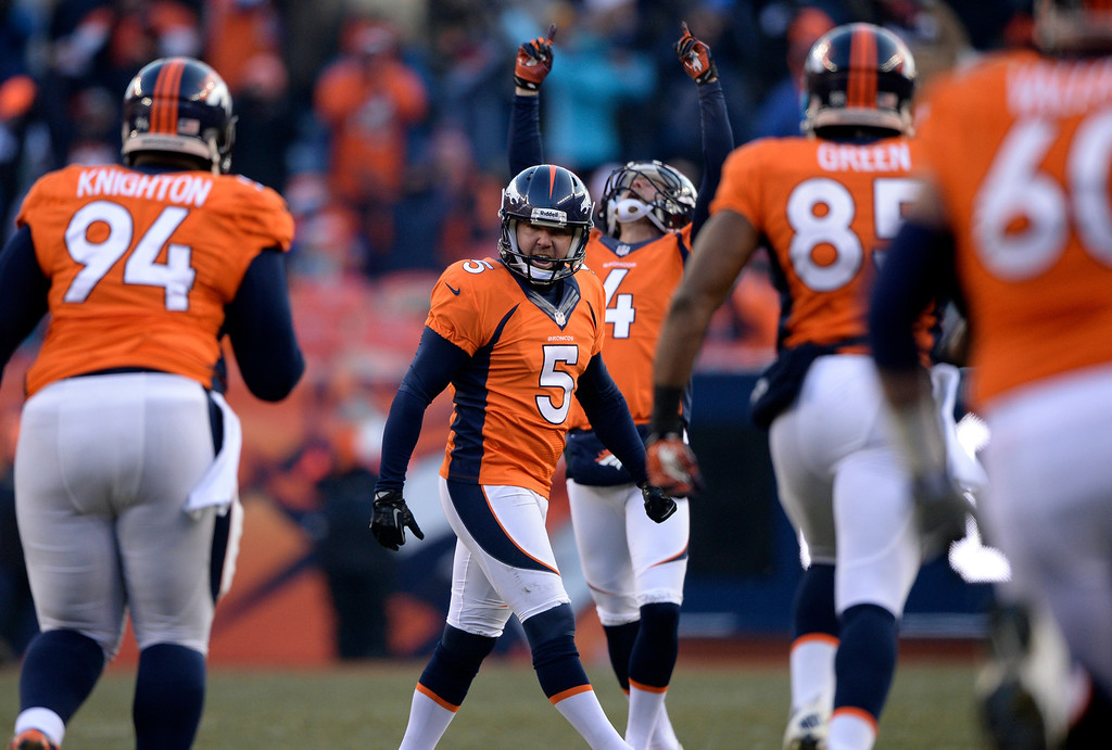 . DENVER, CO - DECEMBER 8: Denver Broncos kicker Matt Prater (5) celebrates after kicking a record breaking 64 yard field goal in the second quarter.  The Denver Broncos vs. the Tennessee Titans at Sports Authority Field at Mile High in Denver on December 8, 2013. (Photo by Hyoung Chang/The Denver Post)