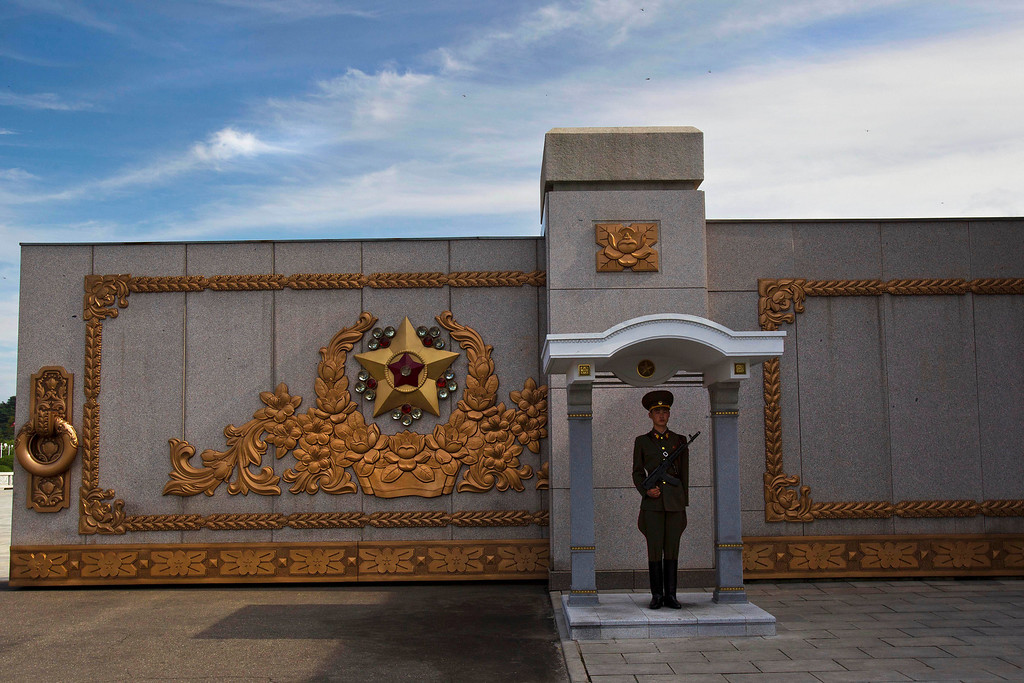 . A North Korean soldier stands guard at his post at the entry gate to the Kumsusan Palace of the Sun, the mausoleum where the bodies of the late leaders Kim Il Sung and Kim Jong Il lie embalmed, in Pyongyang on Thursday, July 25, 2013. (AP Photo/David Guttenfelder)