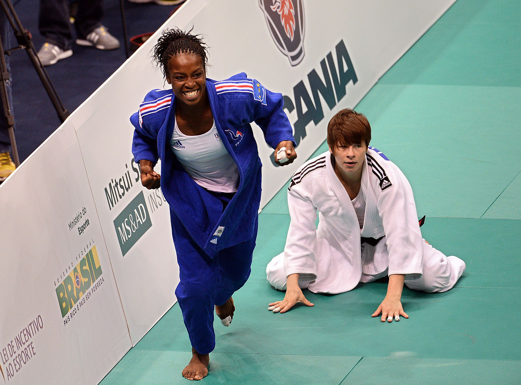 . France\'s Gevrise Emane(blue) celebrates after defeating Slovakia\'s Tina Trstenjak in the Women\'s 63kg category bronze final of the IJF World Judo Championship in Rio de Janeiro, Brazil, on August 29, 2013. VANDERLEI ALMEIDA/AFP/Getty Images