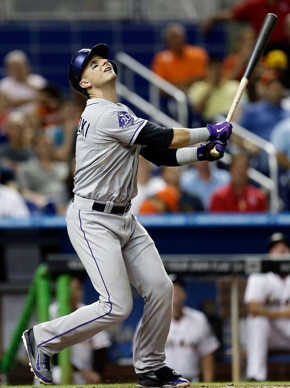 . Colorado Rockies batter Troy Tulowitzki flies out during the ninth inning of a baseball gameagainst the Miami Marlins, Saturday, Aug. 24, 2013, in Miami. The Marlins won 3-0. (AP Photo/J Pat Carter)