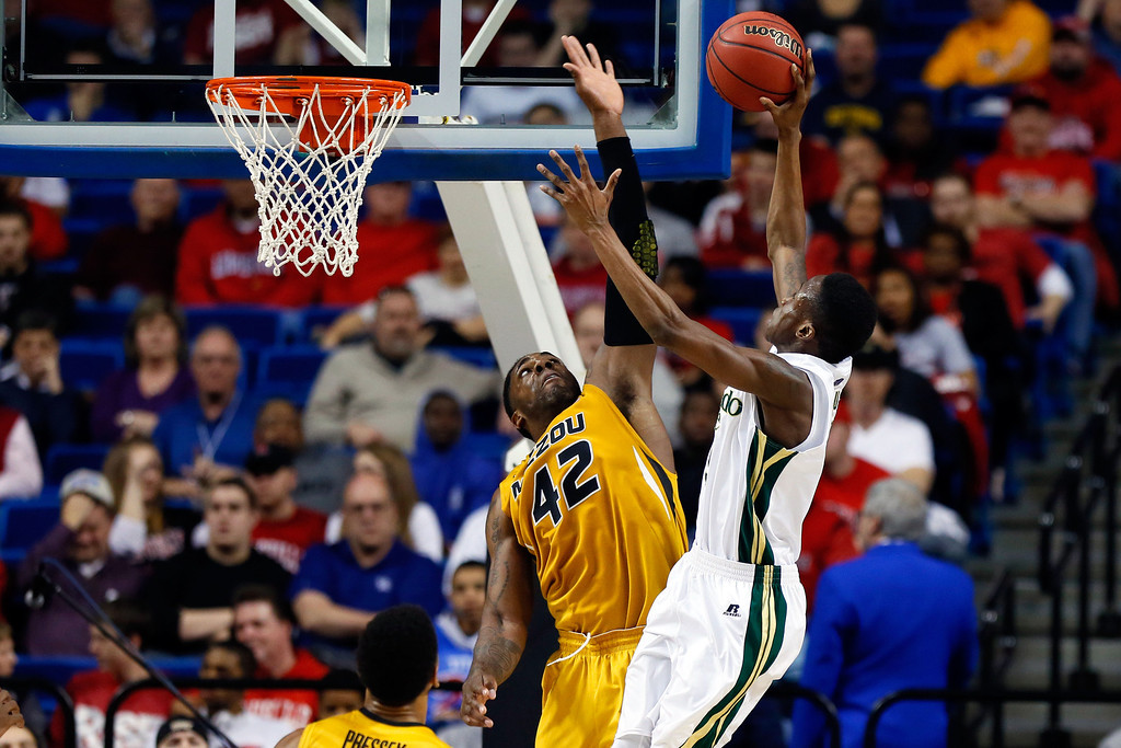 . LEXINGTON, KY - MARCH 21:  Alex Oriakhi #42 of the Missouri Tigers blocks the shot of Jon Octeus #5 of the Colorado State Rams during the second round of the 2013 NCAA Men\'s Basketball Tournament at the Rupp Arena on March 21, 2013 in Lexington, Kentucky.  (Photo by Kevin C. Cox/Getty Images)