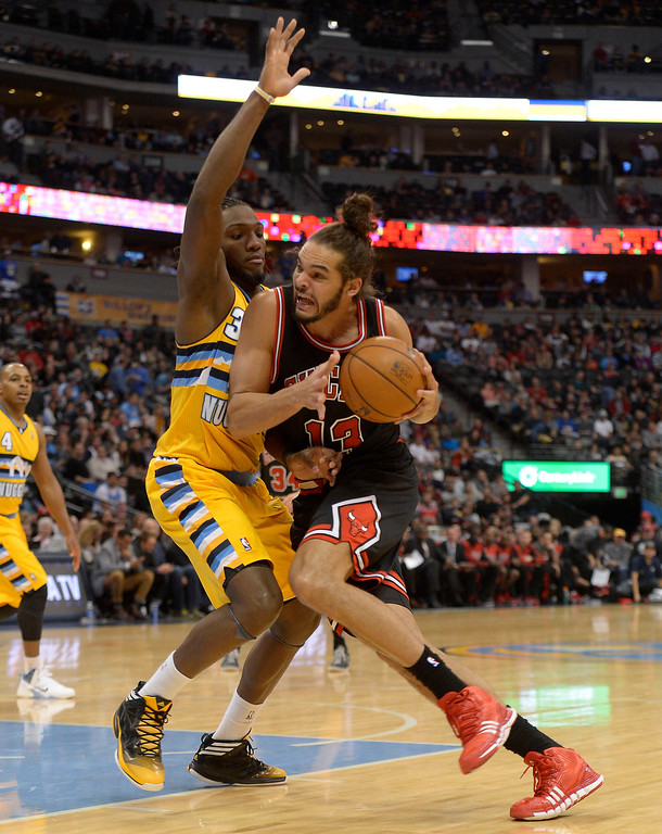 . Chicago Bulls center Joakim Noah (13) drives on Denver Nuggets power forward Kenneth Faried (35) during the third quarter November 21, 2013 at Pepsi Center. (Photo by John Leyba/The Denver Post)