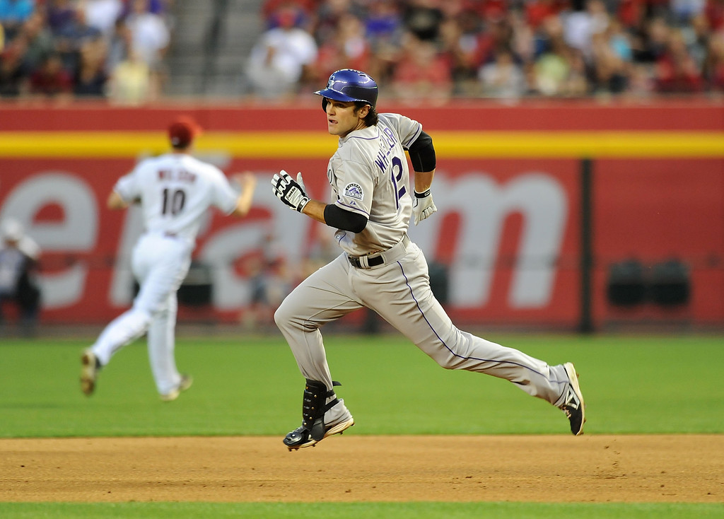 . PHOENIX, AZ - APRIL 25:  Ryan Wheeler #12 of the Colorado Rockies rounds first base after hitting a double against the Arizona Diamondbacks at Chase Field on April 25, 2013 in Phoenix, Arizona.  (Photo by Norm Hall/Getty Images)