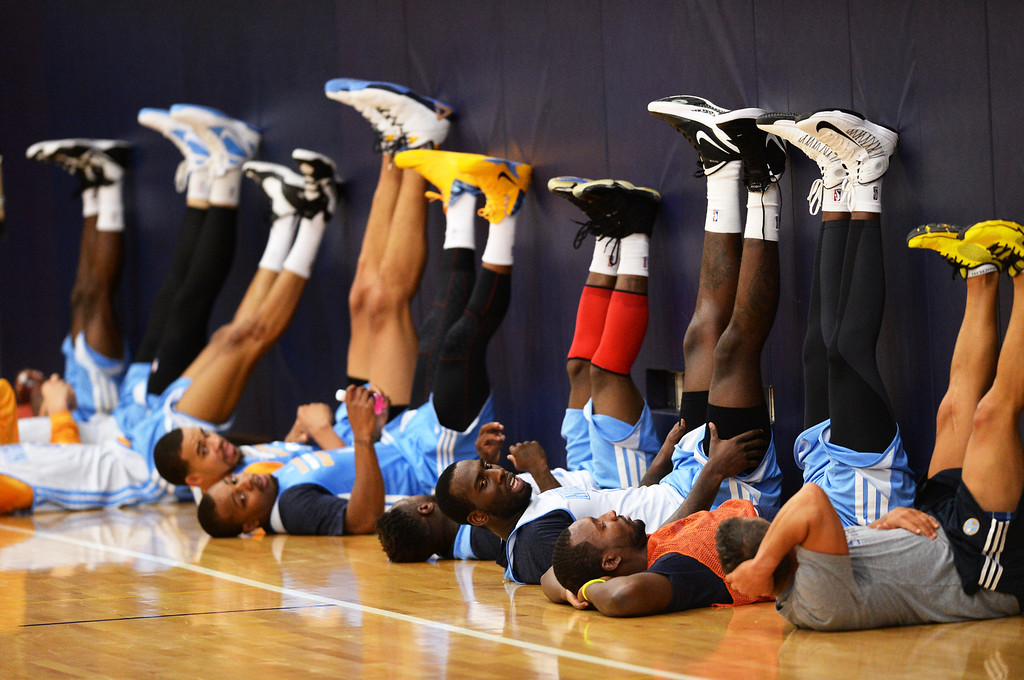 . J.J. Hickson of Denver Nuggets (7) and teammates are stretching after the team practice at Pepsi Center. Denver, Colorado. October 2, 2013. (Photo by Hyoung Chang/The Denver Post)