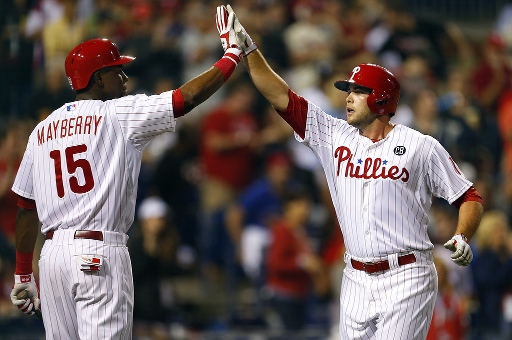 . Darin Ruf #18 of the Philadelphia Phillies is congratulated by teammate John Mayberry Jr. #15 after hitting a home run during the fifth inning in a game against the Colorado Rockies at Citizens Bank Park on May 27, 2014 in Philadelphia, Pennsylvania. (Photo by Rich Schultz/Getty Images)
