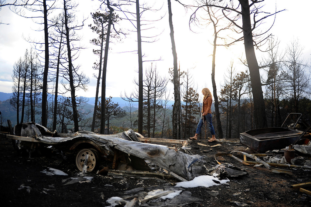. Kristen Moeller and her husband, David Cottrell, as they look through the remains of their home of nine years which was burned during the Lower North Fork Fires on Thursday, April 5, 2012. AAron Ontiveroz, The Denver Post