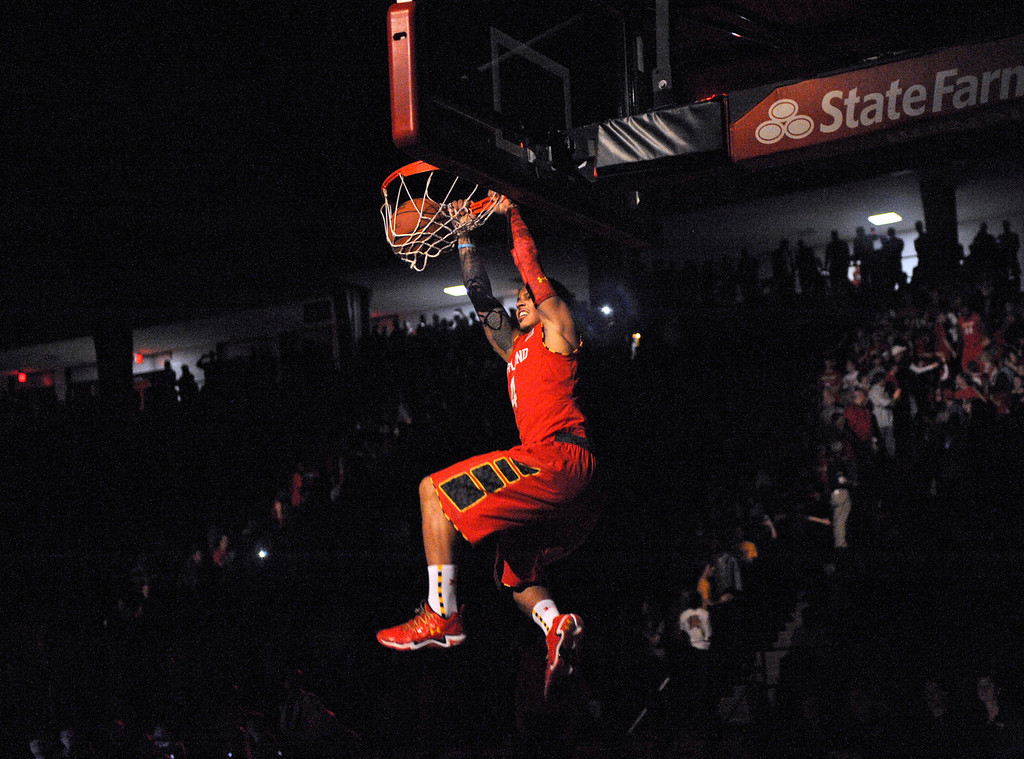 . Maryland\'s Seth Allen dunks during Maryland Madness college basketball events, Friday, Oct. 18, 2013, in College Park, Md. (AP Photo/Nick Wass)