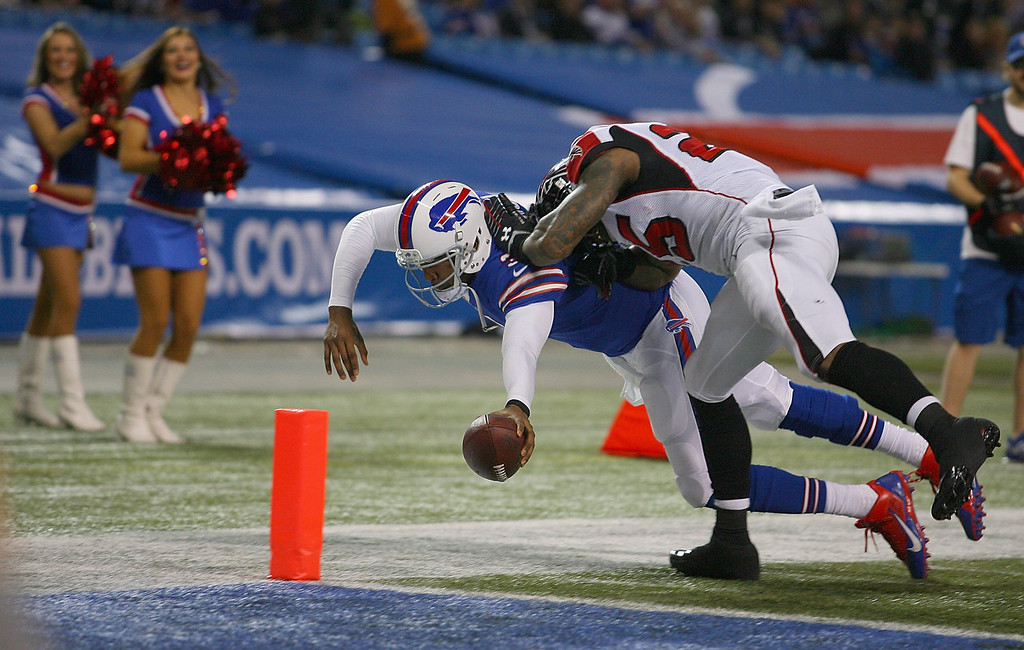 . EJ Manuel #3 of the Buffalo Bills dives for the pylon to score against  William Moore #25 of the Atlanta Falcons at Rogers Centre on December 1, 2013 in Toronto, Ontario.  (Photo by Rick Stewart/Getty Images)