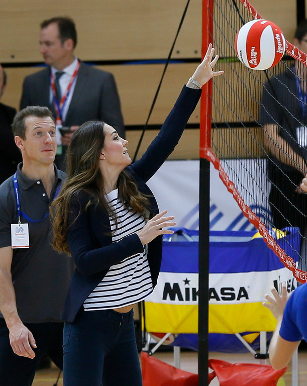 . Britain\'s Kate, The Duchess of Cambridge plays volleyball during a visit to a SportsAid Athlete Workshop, at the Queen Elizabeth Olympic Park in London, Friday, Oct. 18, 2013. The Duchess of Cambridge as Patron of SportsAid attended a SportsAid Athlete Workshop at the Copper Box where she viewed young athletes taking part in a number of sports activities. (AP Photo/Kirsty Wigglesworth)