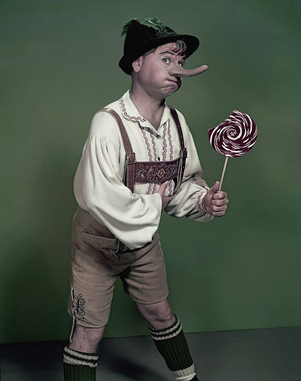 """. Actor Mickey Rooney portrays \""""Pinnochio,\"""" in this September 1957, file photo. Rooney, a Hollywood legend whose career spanned more than 80 years, has died. He was 93. Los Angeles Police Commander Andrew Smith said that Rooney was with his family when he died Sunday, April 6, 2014, at his North Hollywood home. (AP Photo/File)"""