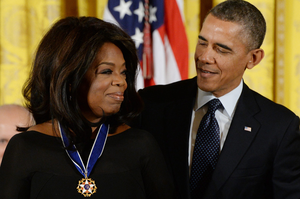 . US President Barack Obama (R) awards the Presidential Medal of Freedom to Oprah Winfrey (L), in the East Room of the White House in Washington DC, USA, 20 November 2013. The Medal of Freedom is the highest civilian honor presented to individuals who have made especially meritorious contributions to the security or national interests of the US, to world peace, or to cultural or other significant public or private endeavors.  EPA/MICHAEL REYNOLDS