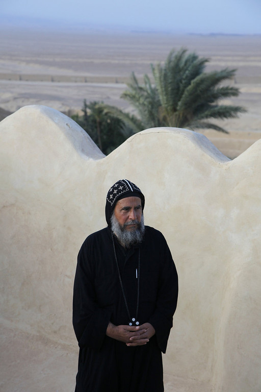 . Father Bakhomious stands on the roof of the ancient monastery of St. Anthony, southeast of Cairo, Egypt on Tuesday, April 16, 2013. In a cave high in the desert mountains of eastern Egypt, the man said to be the father of monasticism took refuge from the temptations of the world some 17 centuries ago. The monks at the St. Anthony\'s Monastery bearing his name continue the ascetic tradition. But even they are not untouched by the turbulent times facing Egypt\'s Christians, defiantly vowing their community\'s voice won\'t be silenced amid Islamists\' rising power. (AP Photo/Manoocher Deghati)
