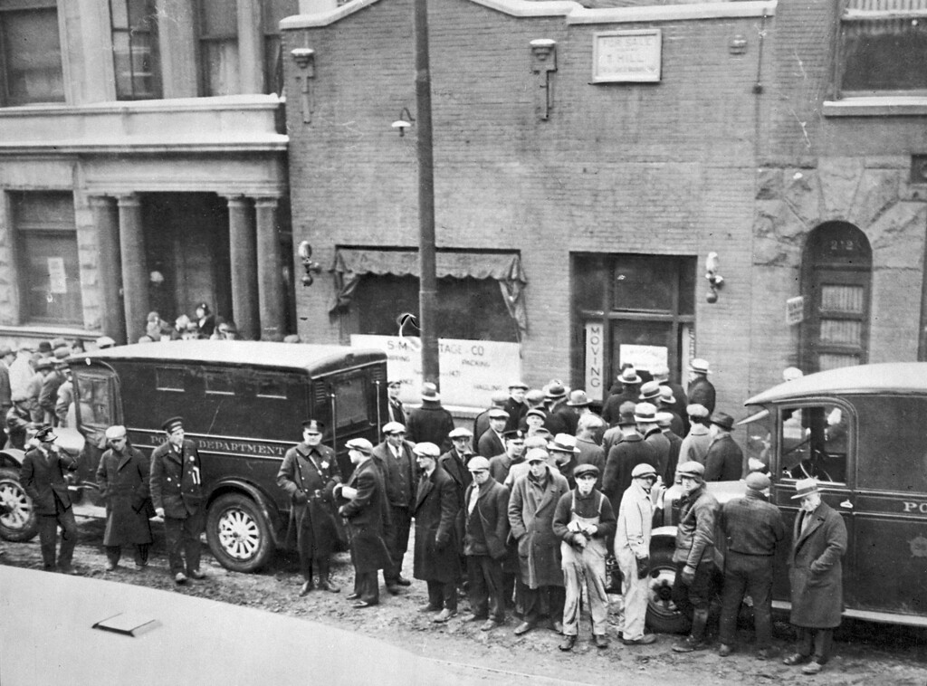 """. A photo provided by the Chicago History Museum shows police and people in front of the S.M.C. Cartage Co. garage on North Clark in Chicago on Feb. 14, 1929 following the St. Valentine\'s Day massacre. Five henchmen from mobster Al Capone\'s gang killed seven members of George \""""Bugs\"""" Moran\'s gang inside the garage. While Chicago officials today shun any association with the famous gangster, visitors still flock to the city searching for anything to do with Capone, who died 60 years ago on Jan. 25, 1947. (AP Photo/Chicago History Museum)"""