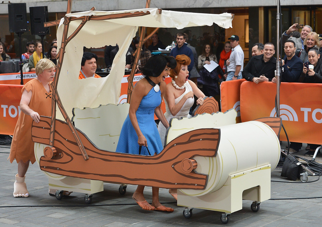 """. Kathie Lee Gifford (L) and Hoda Kotb, dressed as Flintstone characters Wilma Flintstone and Betty Rubble, attend NBC\'s \""""Today\"""" Halloween 2013 in Rockefeller Plaza on October 31, 2013 in New York City.  (Photo by Slaven Vlasic/Getty Images)"""