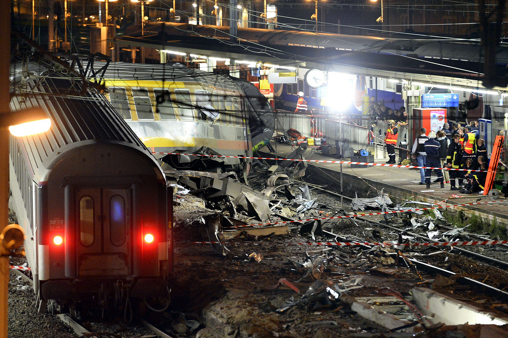 . Rescuers work at night on the site of a train accident on July 12, 2013 at the railway station of Bretigny-sur-Orge, near Paris. At least six people were killed and dozens injured after a speeding train derailed at the station.   LIONEL BONAVENTURE/AFP/Getty Images