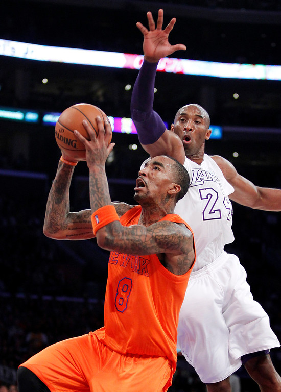 . New York Knicks guard J.R. Smith (8) shoots as Los Angeles Lakers guard Kobe Bryant (24) defends during the second half of their NBA basketball game in Los Angeles, Tuesday, Dec. 25, 2012. The Lakers won 100-94. (AP Photo/Alex Gallardo)