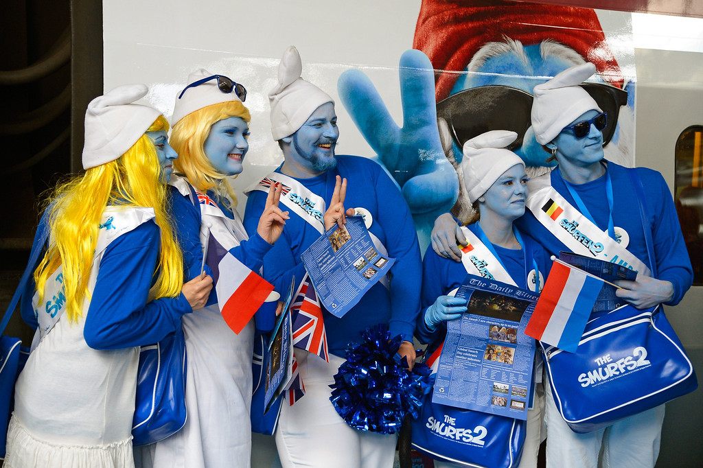 . Smurf Ambassadors prepare to board a branded high speed train from Brussels to Paris as part of Global Smurfs Day celebrations on June 22, 2013 at Brussels railway station, Belgium.  (Photo by Pascal Le Segretain/Getty Images for Sony Pictures Entertainment)