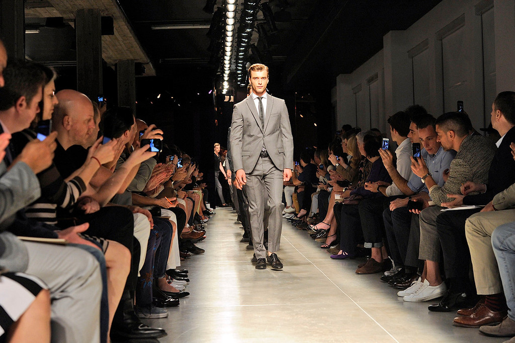 . Models on parade at the end of the Bottega Veneta men\'s Spring-Summer 2014 collection, part of the Milan Fashion Week, unveiled in Milan, Italy, Sunday, June 23, 2013.  (AP Photo/Giuseppe Aresu)