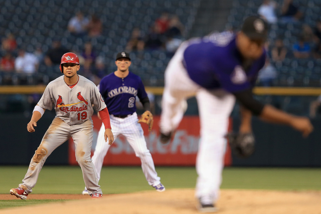 . Jon Jay #19 of the St. Louis Cardinals leads off of second base as pitcher Juan Nicasio #12 of the Colorado Rockies delivers and shortstop Troy Tulowitzki #2 of the Colorado Rockies plays defense at Coors Field on September 17, 2013 in Denver, Colorado.  (Photo by Doug Pensinger/Getty Images)