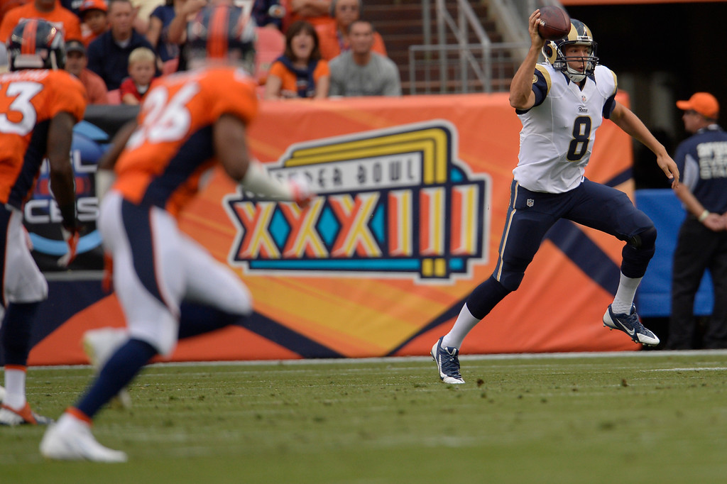 . DENVER, CO. - August 24: Quarterback Sam Bradford (8) of the St. Louis Rams scrambles during the first half of action against the Denver Broncos. The Denver Broncos vs the St. Louis Rams during the 3rd pre-season game of the season at Sports Authority Field at Mile High. August 24, 2013 Denver, Colorado. (Photo By Joe Amon/The Denver Post)