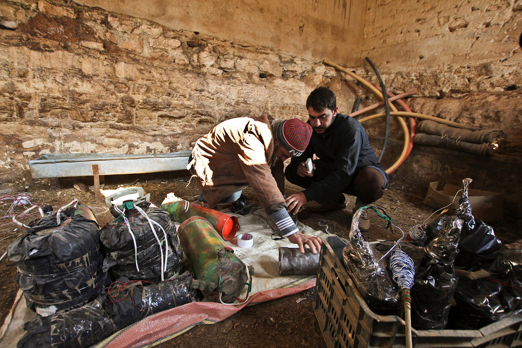 . Syrian brothers who used to be musicians make homemade explosives for the Free Syrian Army in the Ma\'ar Shamarine village near Idlib January 15, 2013. REUTERS/Ghaith Taha