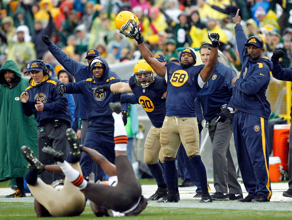 . The Green Bay Packers bench celebrates after cornerback Davon House intercepted a pass during the first half of an NFL football game against the Cleveland Browns Sunday, Oct. 20, 2013, in Green Bay, Wis. (AP Photo/Mike Roemer)