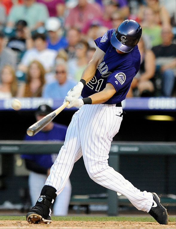 . Colorado Rockies Tyler Colvin hits a two-run home run in the fifth inning of a baseball game against the Washington Nationals on Tuesday, June 11, 2013 in Denver. (AP Photo/Chris Schneider)