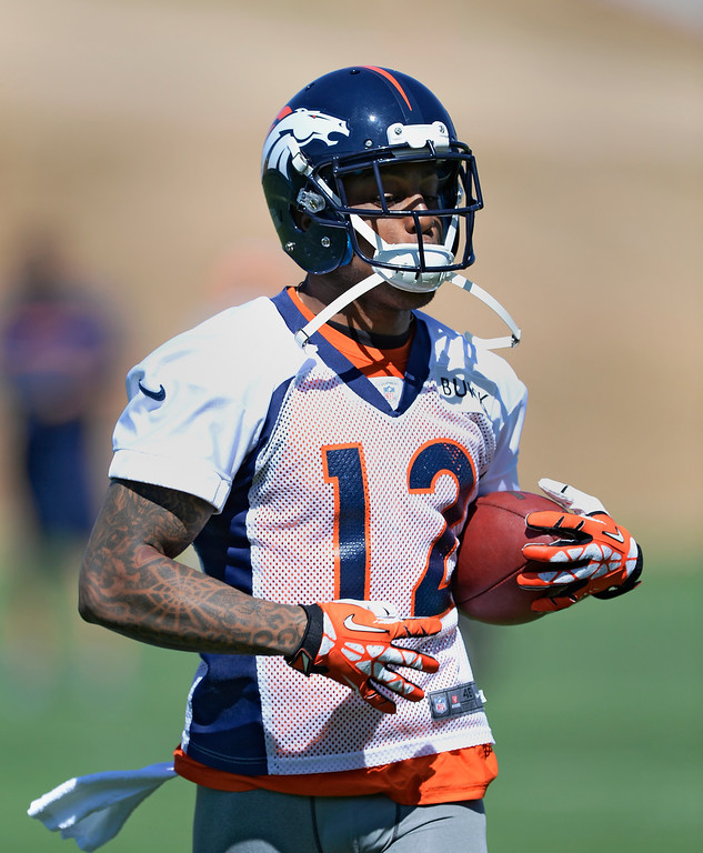 . Denver Broncos wide receiver Andre Caldwell (12) catches a pass during OTAs  June 2, 2014 at Dove Valley. (Photo by John Leyba/The Denver Post)
