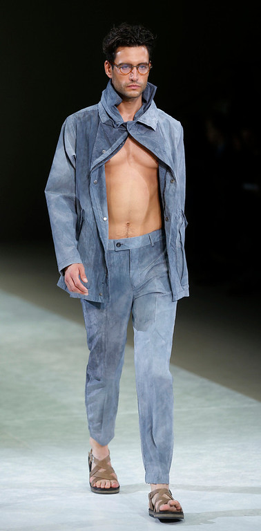 . A model wears a creation for Giorgio Armani men\'s Spring-Summer 2015 collection, part of the Milan Fashion Week, unveiled in Milan, Italy, Tuesday, June 24, 2014. (AP Photo/Luca Bruno)