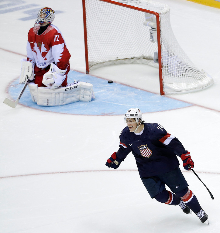 . USA forward T.J. Oshie reacts after scoring the winning goal against Russia goaltender Sergei Bobrovski in a shootout during overtime of a men\'s ice hockey game at the 2014 Winter Olympics, Saturday, Feb. 15, 2014, in Sochi, Russia. (AP Photo/David J. Phillip )