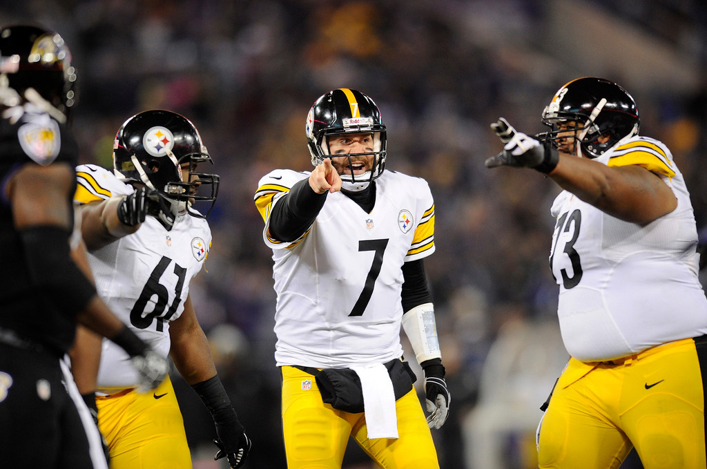 . Pittsburgh Steelers quarterback Ben Roethlisberger (7) speaks with teammates Fernando Velasco, left, and Ramon Foster before running a play in the second half of an NFL football game against the Baltimore Ravens, Thursday, Nov. 28, 2013, in Baltimore. (AP Photo/Nick Wass)