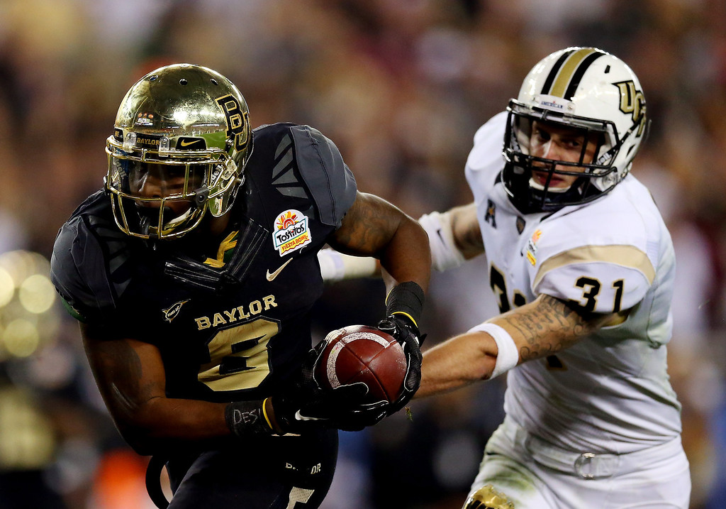 . Running back Glasco Martin #8 of the Baylor Bears scores a fourth quarter touchdown against the UCF Knights during the Tostitos Fiesta Bowl at University of Phoenix Stadium on January 1, 2014 in Glendale, Arizona.  (Photo by Ronald Martinez/Getty Images)