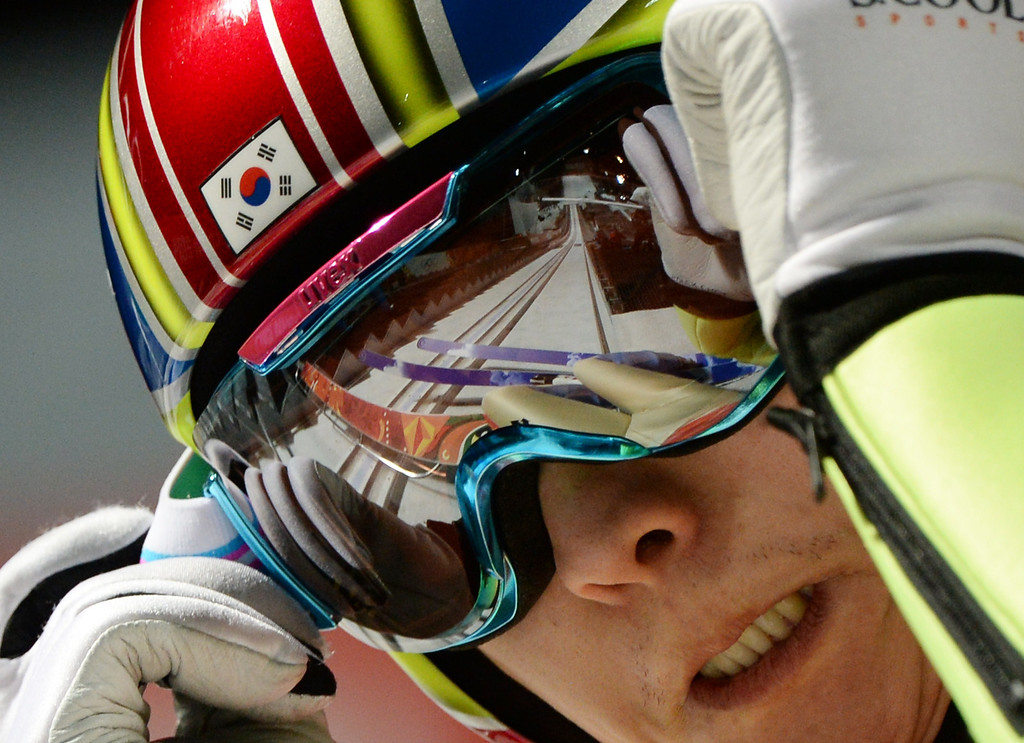 . Korea\'s Heung Chui Choi prepares before his Men\'s Ski Jumping Large Hill second Official training jump at the RusSki Gorki Jumping Center during the Sochi Winter Olympics on February 13, 2014 in Rosa Khutor near Sochi. PETER PARKS/AFP/Getty Images