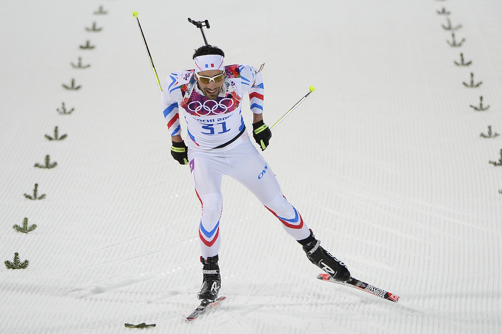 . France\'s Martin Fourcade (31) crosses the finish in the Men\'s Biathlon 20 km Individual at the Laura Cross-Country Ski and Biathlon Center during the Sochi Winter Olympics on February 13, 2014 in Rosa Khutor near Sochi.   PIERRE-PHILIPPE MARCOU/AFP/Getty Images