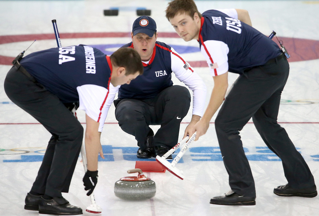 . John Shuster (C) of the USA in action, as Jared Zezel (R) and John Landsteiner (L) of USA sweep during the Round Robin match between China and USA of the Men\'s Curling Competition in the Ice Cube Curling Center at the Sochi 2014 Olympic Games, Sochi, Russia, on Feb. 11, 2014.  EPA/TATYANA ZENKOVICH