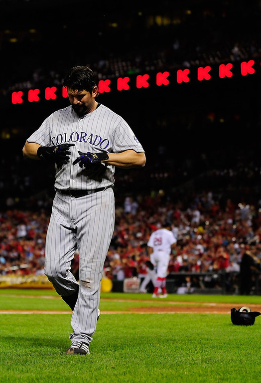 . Todd Helton #17 of the Colorado Rockies walks off the field after being struck out by Octavio Dotel #28 of the St. Louis Cardinals with the bases loaded at Busch Stadium on August 14, 2011 in St. Louis, Missouri.  (Photo by Jeff Curry/Getty Images)