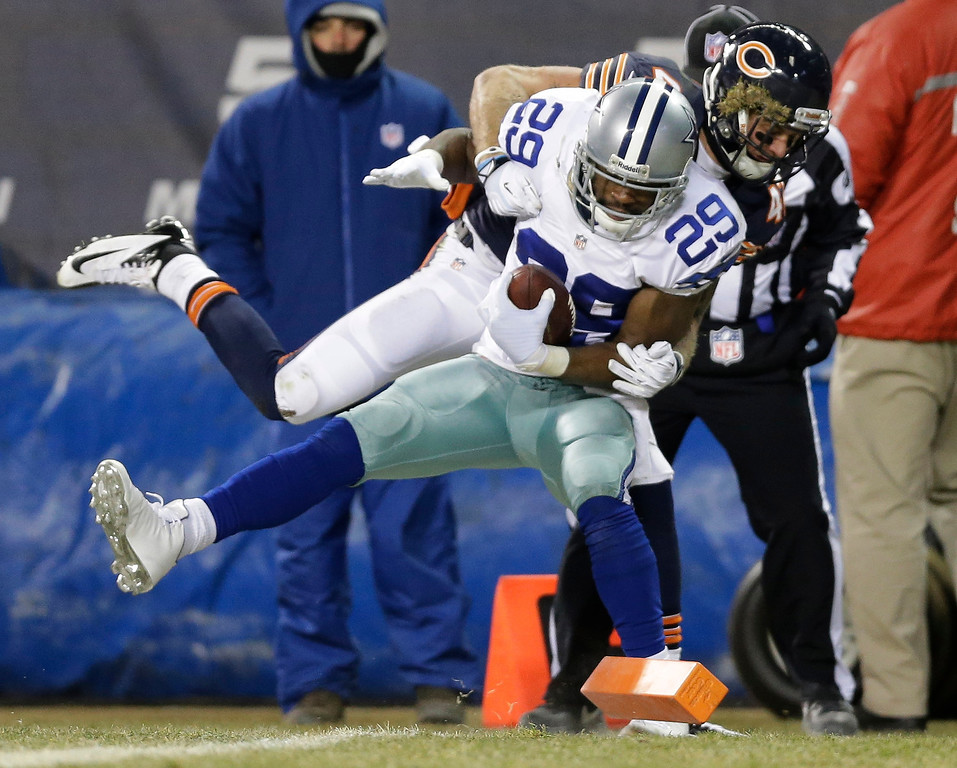 . Chicago Bears safety Chris Conte pulls Dallas Cowboys running back DeMarco Murray (29) out of bounds before the end zone during the first half of an NFL football game, Monday, Dec. 9, 2013, in Chicago. (AP Photo/Nam Y. Huh)