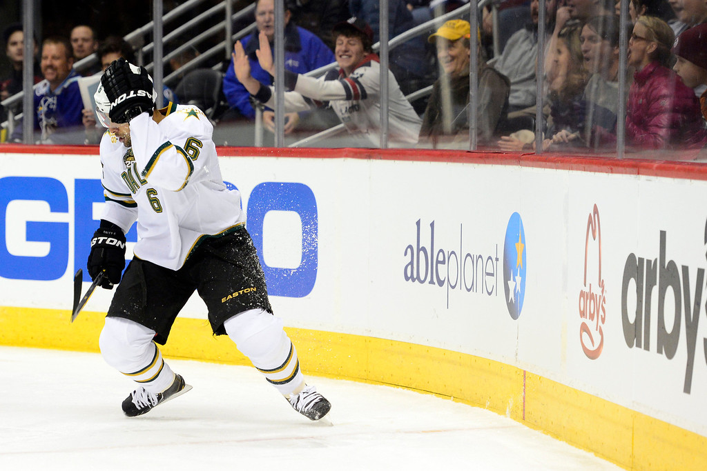 . DENVER, CO. - FEBRUARY 4: Trevor Daley (6) of the Dallas Stars rubs his head after being checked by Cody McLeod (55) of the Colorado Avalanche during the first period of action. Colorado Avalanche versus the Dallas Stars at the Pepsi Center on February 4, 2012. (Photo By AAron Ontiveroz/The Denver Post)