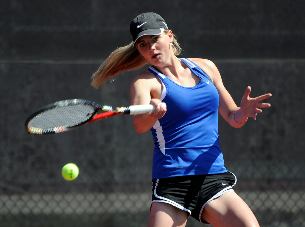 . Madison Porter from Legend High School returns the ball to Rebecca Weissmann from Loveland High School in the #1 Singles Bracket.  (Photo By Kathryn Scott Osler/The Denver Post)