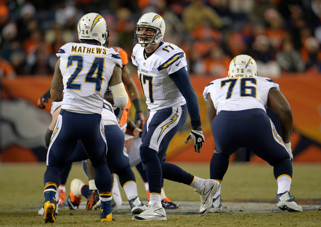 . San Diego Chargers quarterback Philip Rivers (17) running the offense during the first quarter. The Denver Broncos vs. the San Diego Chargers at Sports Authority Field at Mile High in Denver on December 12, 2013. (Photo by Joe Amon/The Denver Post)