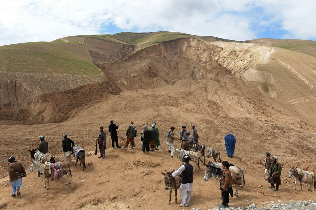 . A general scene of the massive landslide is pictured as villagers look on at Aab Bareek village in Argo district of Badakhshan on May 5, 2014. Rescue teams abandoned the search for survivors May 3 after a landslide buried a hillside village in northern Afghanistan. At least 300 were killed, and officials warned the death toll could rise by hundreds more. A total of 700 families were left homeless in the mountains. AFP PHOTO/SHAH MARAI/AFP/Getty Images