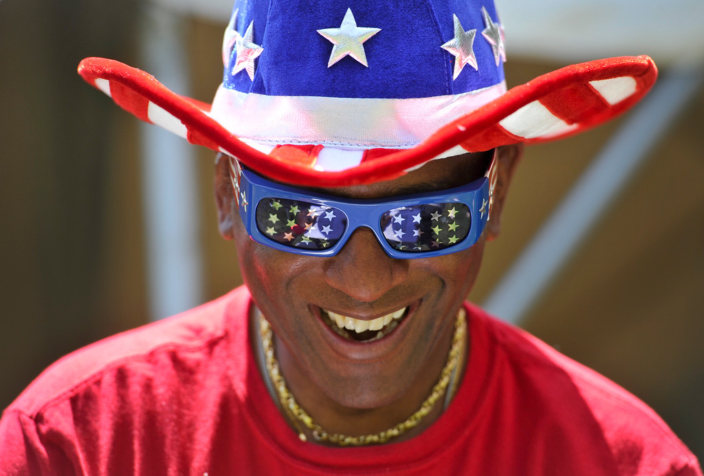 . Bobby King shares a laugh with a friend, Thursday, July 4, 2013, at Thompson Park in Longmont. (Matthew Jonas/Times-Call)