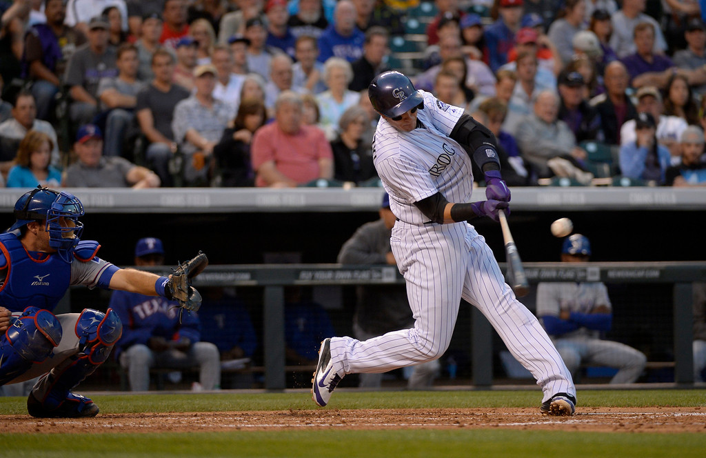 . DENVER, CO - MAY 06: Colorado Rockies shortstop Troy Tulowitzki (2) singles in the third inning against the Texas Rangers May 6, 2014 at Coors Field. (Photo by John Leyba/The Denver Post)