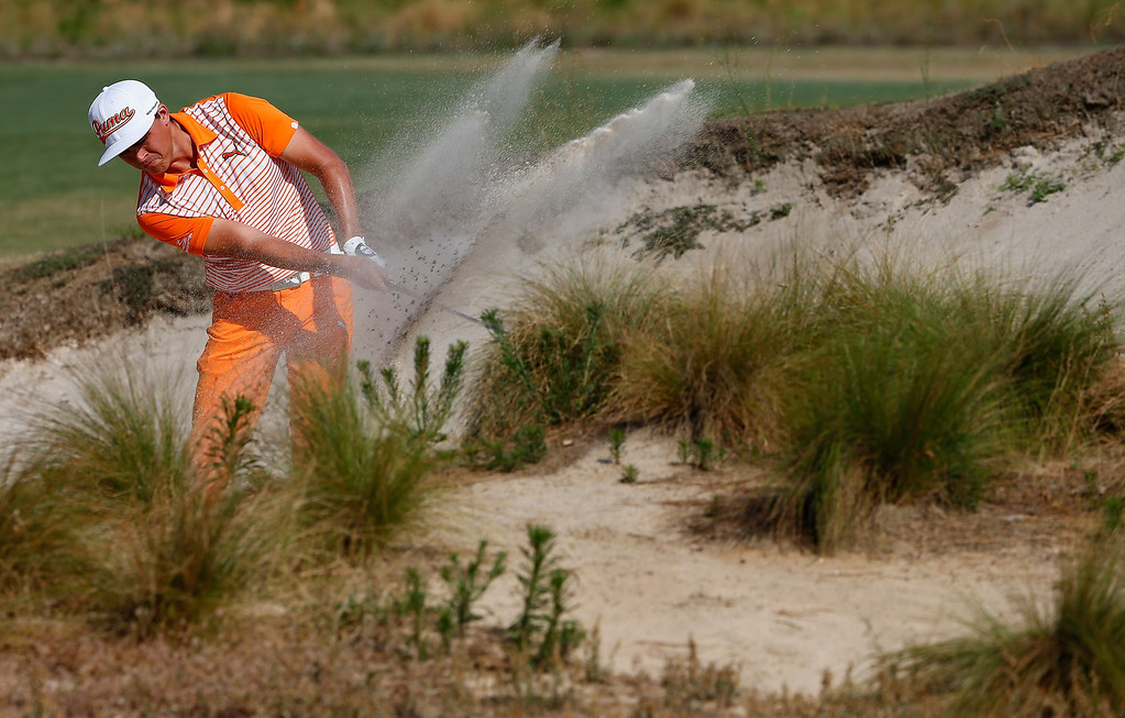 . PINEHURST, NC - JUNE 15: Rickie Fowler of the United States hits his second shot from a bunker on the seventh hole during the final round of the 114th U.S. Open at Pinehurst Resort & Country Club, Course No. 2 on June 15, 2014 in Pinehurst, North Carolina.  (Photo by Sam Greenwood/Getty Images)