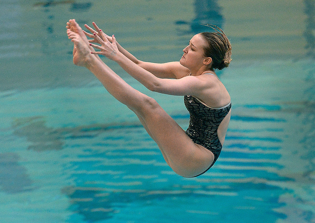 . THORNTON, CO. - FEBRUARY 15, 2014: Moncarch diver Savannah Magness twisted through the air on her first dive Saturday. The CHSAA 5A Girl\'s State Swimming Championships wrapped up Saturday night February 14, 2104.  Photo By Karl Gehring/The Denver Post