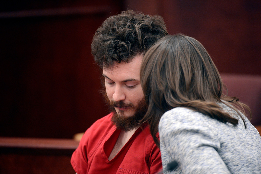 . Defense attorney Tamara Brady talks to defendant James Holmes during his arraignment in Centennial, Colo., on Tuesday, March 12, 2013.  (AP Photo/Denver Post, RJ Sangosti, Pool)