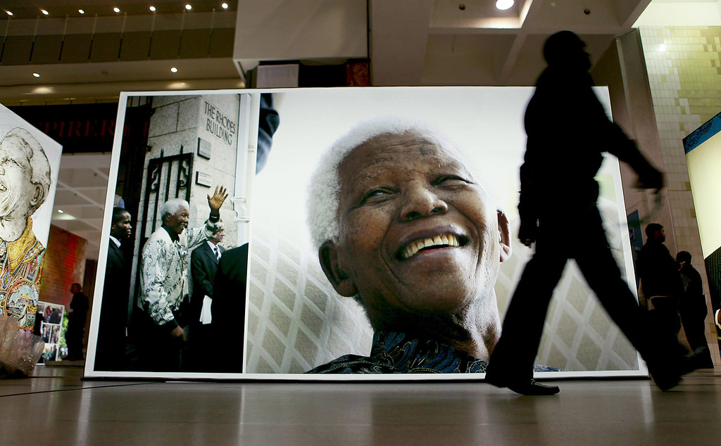 . CAPE TOWN, SOUTH AFRICA - JUNE 27:  A person walk past  a display at the Cape Town Honours Nelson Mandela exhibition at the Cape Town Civic Centre as part of the Cape Town Honours Nelson Mandela exhibition on June 27, 2013 in Cape Town, South Africa.    South African President Jacob Zuma confirmed on June 23 that Mandela\'s condition has become critical since he was admitted to the hospital over two weeks ago for a recurring lung infection.  Photo by Michelly Rall/Getty Images)