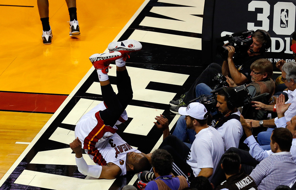 . MIAMI, FL - JUNE 10: Dwyane Wade #3 of the Miami Heat falls down against the San Antonio Spurs during Game Three of the 2014 NBA Finals at American Airlines Arena on June 10, 2014 in Miami, Florida. (Photo by Chris Trotman/Getty Images)